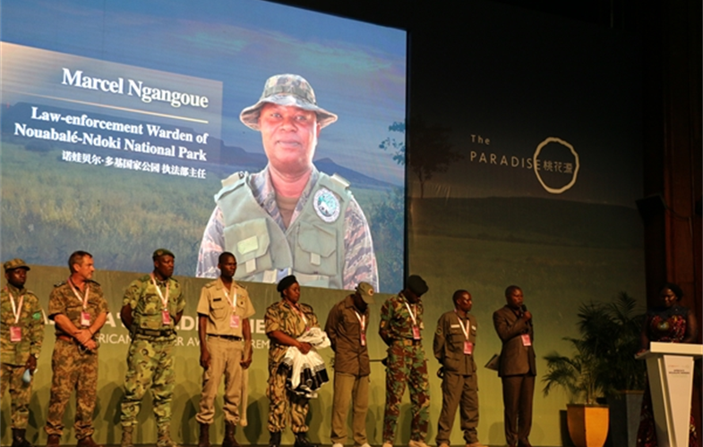 Marcel Ngangoue (standing to the left of the podium), Head of Conservation of Biodiversity and Law enforcement at Nouabale-Ndoki National Park stands with other rangers